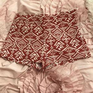 Red and white woven flat front shorts
